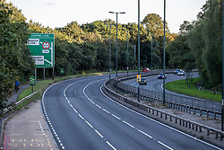 Licensed to London News Pictures. 27/09/2021. Dorking, UK. A very quiet rush hour on the A3 Kingston Bypass south-west London this evening (17:46), a major road in and out of the Capital and usually synonymous with long tailbacks as motorists continue to struggle to find petrol stations with fuel. Large queues have formed at petrol stations across the country over the weekend with many running out of fuel as oil giants struggle to maintain deliveries due to the lack of HGV drivers. Photo credit: Alex Lentati/LNP