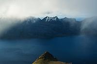 Mountains of Flakstadøy concealed in clouds from summit of Skottind, Vestvågøy, Lofoten Islands, Norway