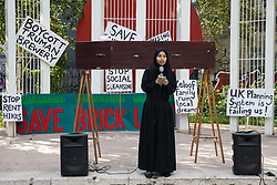 London, UK. 12th September, 2021. Hajera Begum of Nijjor Manush addresses local residents and supporters of the Save Brick Lane campaign in Altab Ali Park before a funeral procession along Brick Lane organised in protest against the ongoing gentrification of Shoreditch. Campaigners are protesting in particular against plans to develop the Truman Brewery into a shopping centre and 5-storey office building. Tower Hamlets experienced more gentrification than any other London borough between 2010-2016.