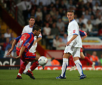 Photo: Chris Ratcliffe.<br /> Crystal Palace v Southend United. Coca Cola Championship. 08/08/2006.<br /> Freddy Eastwood (R) of Southend turns the ball away from Danny Butterfield of Crystal Palace.