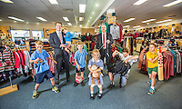 Three Generations story. Bob Stewart Clothing in Kew. Francis (holding child) and Robert Stewart with Francis' kids (from left), Patrick 9yrs, Jack 3yrs, Lachlan 8yrs, and Madeleine 5yrs, and Roberts kids Cian 11yrs and Pierce 9yrs. Photo by Craig Sillitoe 25/03/2013