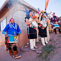 102712       Cable Hoover<br /> <br /> Presley Kaamasee, left, and other wait for their turn to dance in the Zuni Harvest Festival in Zuni Saturday.