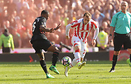Liverpool's Georgina Wijnaldum battles for the ball with Stoke's Sheridan Shaqiri . Premier league match, Stoke City v Liverpool at the Bet365 Stadium in Stoke on Trent, Staffs on Saturday 8th April 2017.<br /> pic by Bradley Collyer, Andrew Orchard sports photography.