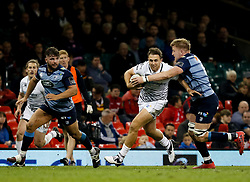 Ospreys' Ashley Beck is tackled by Cardiff Blues' Macauley Cook<br /> <br /> Photographer Simon King/Replay Images<br /> <br /> Guinness PRO14 Round 21 - Cardiff Blues v Ospreys - Saturday 28th April 2018 - Principality Stadium - Cardiff<br /> <br /> World Copyright © Replay Images . All rights reserved. info@replayimages.co.uk - http://replayimages.co.uk