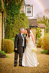 Couple kissing with rainbow in background at the Walnut Tree Inn, Northampton