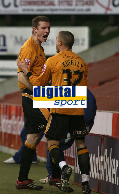 Photo: Mark Stephenson.<br />Stoke City v Wolverhampton Wanderers. Coca Cola Championship. 13/01/2007.<br />Wolves' goal scorer Neil Collins (L) celebrates with team mate Michael Kightly.