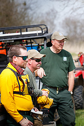 Burn boss debriefing team and volunteers after controlled burn on Wilt's Prairie, a Blackland Prairie remnant near Ennis, Texas, south of Dallas. Texas, USA.
