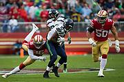 San Francisco 49ers cornerback Dontae Johnson (36) tackles Seattle Seahawks wide receiver Paul Richardson (10) at Levi's Stadium in Santa Clara, Calif., on November 26, 2017. (Stan Olszewski/Special to S.F. Examiner)