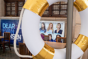Portraits of cast members for the 'Dear Evan Hansen' musical are seen through a life ring outside the Noel Coward Theatre on St. Martin's Lane in the heart of the capital's West End Theatreland, still closed to audiences during the Coronavirus pandemic, on 29th September 2020, in London, Westminster, England. Despite the government's £1.15bn financial rescue package for the Arts industry and cultural organisations in England , made up of £880m in grants and £270m of repayable loans, London's theatre industry has been hit hard by the pandemic, being closed since the March lockdown closures which has affected 137,250 Arts industry jobs, worth £21.2bn in direct turnover.