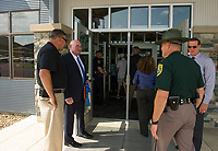 Superintendent Keith Gray greets visitors as they tour the Belknap County Corrections Facility following the grand opening ceremony on Thursday afternoon.  (Karen Bobotas/for the Laconia Daily Sun)