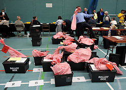Election count staff sort ballot boxes during the local election count at Riverside Ice & Leisure Centre in Chelmsford, Essex.