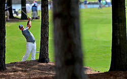 Gary Woodland is framed by the trees along the 18th fairway as he hits his second shot during first round action of the PGA Championship at Quail Hollow Club Thursday, Aug. 10, 2017 in Charlotte, N.C. (Photo by Jeff Siner/Charlotte Observer/TNS/Sipa USA)  *** Please Use Credit from Credit Field ***