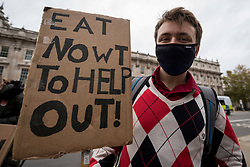 © Licensed to London News Pictures. 24/10/2020. LONDON, UK. People in central London protest against a post-Brexit trade deal with the USA claiming that, amongst other reasons, the NHS and food standards would be negatively affected. Photo credit: Stephen Chung/LNP