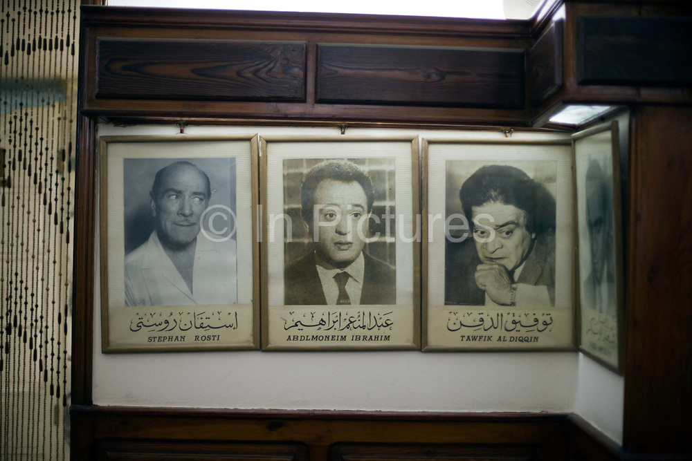 Portraits of famous literary customers line the walls of Cafe Riche, Cairo, Egypt