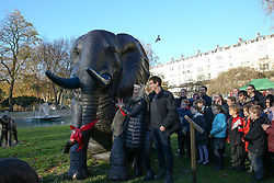 © Licensed to London News Pictures. 04/12/2019. London, UK. Artists GILLIE (L) and Marc (R) unveil a herd of 21 bronze elephants at Marble Arch. The sculpture is the largest such depiction of an elephant herd in the world and is intended to draw attention to the plight of this species that could be extinct on current trends, by 2040. Each elephant in the sculpture is modelled after a real orphaned animal currently in the care of the Sheldrick Wildlife Trust. Left behind by poachers and other sources of human-wildlife conflict these animals have been raised by the trust in an effort to secure the future of the species. The herd will be displayed until 4 December 2020. Photo credit: Dinendra Haria/LNP