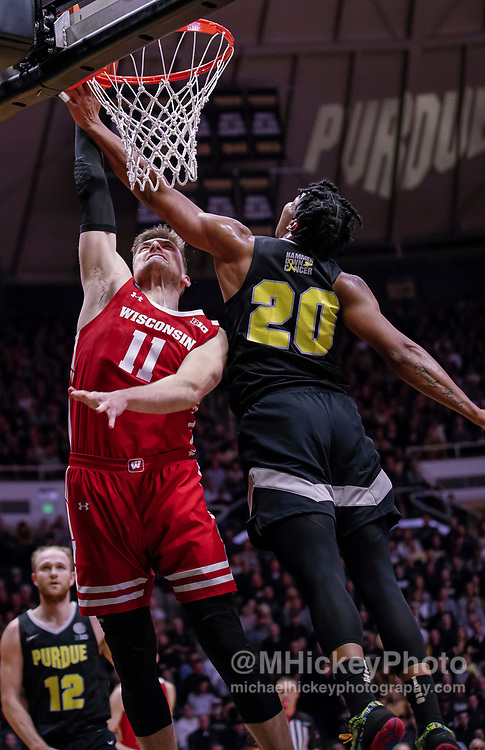 WEST LAFAYETTE, IN - JANUARY 24: Micah Potter #11 of the Wisconsin Badgers shoots the ball against Nojel Eastern #20 of the Purdue Boilermakers at Mackey Arena on January 24, 2020 in West Lafayette, Indiana. (Photo by Michael Hickey/Getty Images) *** Local Caption *** Micah Potter