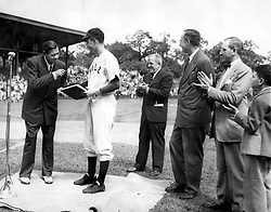 Baseball legend Babe Ruth presents his papers to Yale University in 1948. They are received by Yale baseball team captain, George Bush. Also present are: Bob Kiplurth, Yale Athletic Director; Professor James T. Babb, Yale University Librarian for Preservation; and Mayor Celentano and his son. Photo by George Bush Presidential Library/MCT/ABACAPRESS.COM