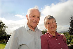 Portrait of a retired couple in the garden, Cumbria.  MODEL RELEASED