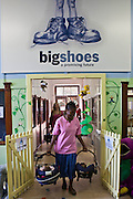 Door of Hope female staff leave the BigShoes clinic with young babies that have just had routine medical examinations in the Bigshoes hospital clinic in Johannesburg, South Africa.  These health check-ups are a necessary part of the adoption process.  BigShoes Foundation is a charity that provides medical care to children living in children's homes and those who have been adopted.