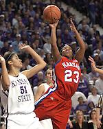 Kansas guard Erica Hallman (R) scores over Kansas State's Marlies Gipson during the first half.   K-State defeated Kansas 69-63 in the Sunflower Showdown at Bramlage Coliseum in Manhattan, Kansas, January 25, 2006.