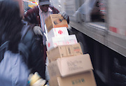 Worker unloading a truck providing goods to a store