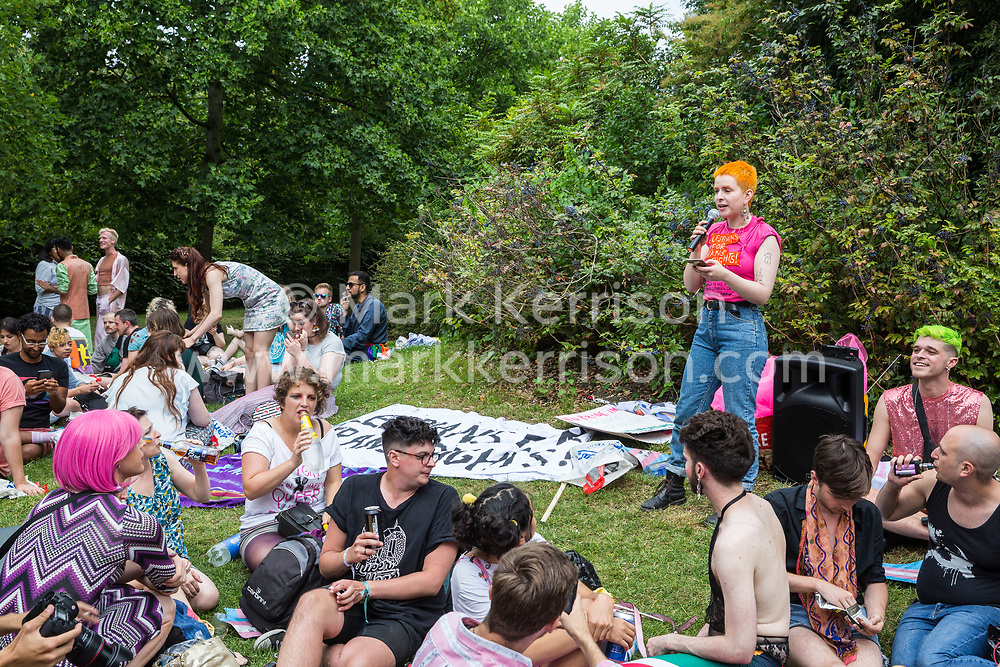 London, UK. 6 July, 2019. A speaker from Lesbians for Trans Rights addresses activists from Lesbians and Gays Support The Migrants, African Rainbow Family, the Outside Project, Micro Rainbow and other LGBT+ groups preparing to take part in a London Pride Solidarity March in solidarity with those for whom Pride in London is inaccessible and in protest against the corporatisation of Pride in London.