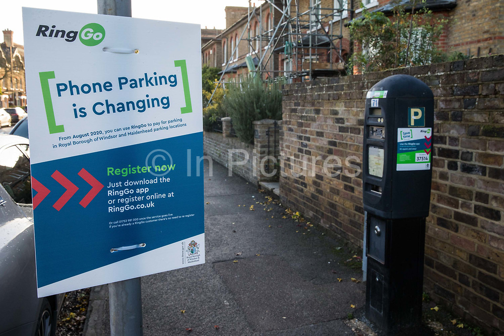 An explanatory notice is displayed alongside a parking meter to be used in conjunction with the RingGo parking application on 31 October 2020 in London, United Kingdom. The Royal Borough of Windsor and Maidenhead switched its cashless phone parking solution from Parkmobile to RingGo with effect from 20th August 2020.