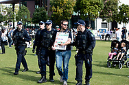 SYDNEY, NSW - SEPTEMBER 05: Police take away a man during the Freedom Day Rally on September 05, 2020 in Sydney, Australia. Protesters argue COVID-19 is a hoax and say their freedoms are being unfairly impinged. Demonstrations are also taking place in every Australian capital city and several regional areas, including Byron Bay. (Photo by Steven Markham/Speed Media)