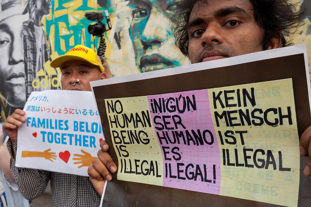 """An Indian activist holding a sign reading: """"No human-being is illegal"""" takes part in the families Belong Together Rally to protest the policy of separating migrant families as they cross the Southern US border carried out by the Administration of President Donald Trump in Tokyo's iconic Hachiko Square in Shibuya, Japan. Saturday June 30th 2018. Around thirty people from Democrats Abroad Japan, along with Japanese and other foreigners, took part in the demo which was part of an international day of action that saw more than 625 protests worldwide."""