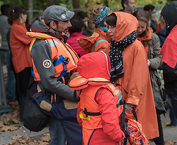 October 6, 2018 - Nantes, France - Demonstration to support Aquarius in Nantes, France, on 6 October 2018. 500 people dressed in orange demonstrated in Nantes to support the Aquarius, the humanitarian boat of the association SOS Mediterranean that helps migrants in distress on makeshift boats.This event, which responded to the call of the NGO whose mission is threatened because of a lack of pavilions, moved out of Square Daviais where hundreds of migrants had installed a camp during the summer because they did not have their own cares. by the authorities. (Credit Image: © Estelle Ruiz/NurPhoto/ZUMA Press)