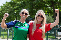 PARIS, FRANCE - Saturday, June 25, 2016: Northern Ireland supporter Diane Boswell and Wales supporter Georgia Milton ahead of the the Round of 16 UEFA Euro 2016 Championship match at the Parc des Princes. (Pic by Paul Greenwood/Propaganda)