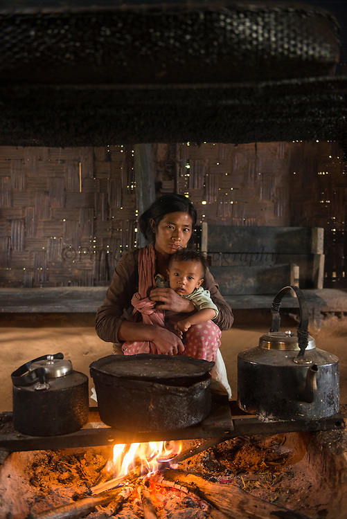 Chang Naga house with cooking fire in center<br /> Chang Naga headhunting Tribe<br /> Tuensang district<br /> Nagaland,  ne India