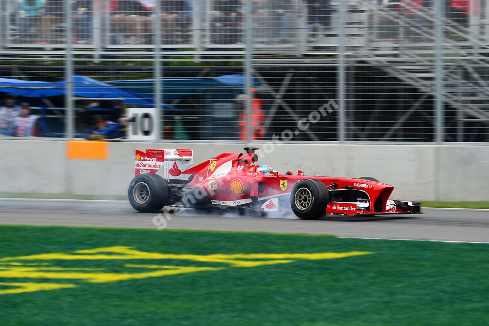 Fernando Alonso (Ferrari) braking hard with smoke from his tyres during practice for the 2013 Canadian Grand Prix at the Ile Notre Dame in Montreal. Photo: Grand Prix Photo