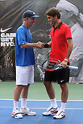 l to r: John McEnroe and  Roger Federer at the Nike Youth Tennis  Challenge held at The Nike -Built regulation Tennis Court  on West 23rd Street & Broadway in New York  City . ..Hundreds of tennis fans and youth form New York  Parks and Rec. Athlethes for Charity, and Mentoring USA are treating to tips and guidance from Tennis Pros Roger Federer, Rafael Nadal and Serena Williams...