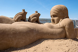 "© Licensed to London News Pictures. 12/05/2019. Weston-super-Mare, North Somerset, UK. The Weston-super-Mare Sand Sculpture Festival at Weston's beach. A sand sculpture titled ""What if all Frogs were Princes?"" by artist Edith de Wetering. The Weston Sand Sculpture Festival promises a new theme each year and this year the broad ""What If…?"" topic has allowed artists to create conceptual pieces of art portraying some important and alarming messages from Brexit, Climate Change to Feminism. Photo credit: Simon Chapman/LNP"