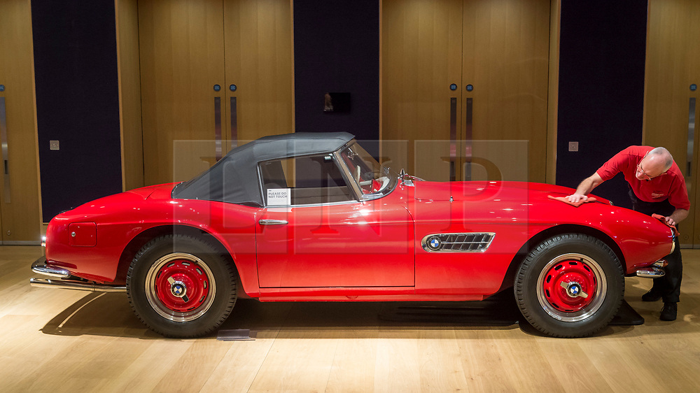 """© Licensed to London News Pictures. 29/11/2018. LONDON, UK. A technician polishes a 1958 BMW 507 3.2-litre Series II Roadster (Est. GBP2.1-2.2m). Preview of a sale of """"Fine Collectors' Motor Cars"""" at Bonhams, New Bond Street.  30 vehicles will be offered for sale on 1 December.  Photo credit: Stephen Chung/LNP"""