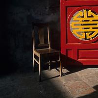Asia, Vietnam, Hanoi, Empty chair sits inside entrance to Ngoc Son Buddhist Temple along Hoan Kiem Lake