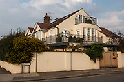 Stormtrooper standing on the terrace of a residential house in Barnes in West London, England, United Kingdom. A stormtrooper is a fictional soldier in the Star Wars franchise.