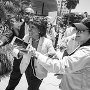 Democratic Congresswoman Maxine Waters is mobbed by supporters as she makes her way through the crowd to speak in Los Angeles at the Families Belong Together demonstration. Over 70,000 people took to downtown Los Angeles to protest against President Trump's immigration policies, in particular the policy to separate children from their parents at the border. ALSO AVAILABLE IN COLOR