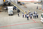 cleaning crew waiting to enter a passenger airplane at Narita International airport Tokyo Japan