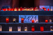 "Candles burn at a makeshift memorial in Berlin, Germany, January 17,  2021. The memorial is part of the initiative  ""Corona-Tote sichtbar machen"" (lit. Make corona deaths visible) by Christian Y. Schmidt and Veronika Radulovic,  since December 6, 2020, people gather at the fountain of Arnswalder Platz every Sunday at 16:00, light candles and place placards with the current death toll reported in Germany at the time. The death toll in Germany by variouse sources revolved around 47,000."