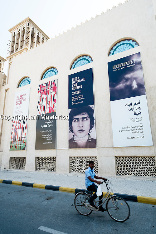 Posters advertising exhibitions on wall of Sharjah Art Museum in United arab Emirates