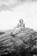 Octavia Hirschman sitting on Old Faithful Petrified Log, Rainbow Forest, Petrified Forest National Park, Arizona (September 1949)