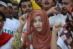 August 28, 2017 - Lahore, Punjab, Pakistan - Pakistani activists of Youth forum for Kashmir chant anti-India slogans during a protest held to oppose abrogation of Article 35A of the Indian Constitution in Lahore. (Credit Image: © Rana Sajid Hussain/Pacific Press via ZUMA Wire)