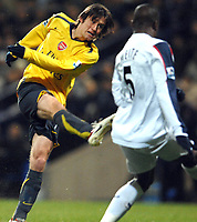 Photo: Paul Greenwood.<br />Bolton Wanderers v Arsenal. The FA Cup. 14/02/2007. Arsenal's Tomas Rosicky, left, shoots at goal past Bolton's Abdoulaye Meite