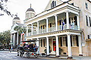 Horse carriage tour along historic Meeting Street in Charleston, South Carolina.