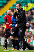 05/10/14 SCOTTISH PREMIERSHIP<br /> CELITC v HAMILTON<br /> CELTIC PARK - GLASGOW<br /> Celtic manager Ronny Deila watches his side on from the dugout