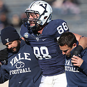 Stephen Buric, Yale, leaves the field injured during the Yale Vs Princeton, Ivy League College Football match at Yale Bowl, New Haven, Connecticut, USA. 15th November 2014. Photo Tim Clayton