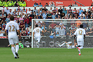 Swansea city's Michu (on ground) scores his sides 2nd goal past West Ham keeper Jussi Jaaskelainen (22) . Barclays Premier league, Swansea city  v West Ham Utd at the Liberty Stadium in Swansea, South Wales  on Saturday 25th August 2012. pic by Andrew Orchard, Andrew Orchard sports photography,