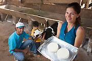Barroso _ MG, 06 de Junho de 2008<br /> <br /> Projeto Ortopolis.<br /> <br /> Na foto, os produtores rurais Lucieder Aparecido, sua esposa Fabiana Cristina e seu filho Lhyuan Pablo. Ele produz um tipo de queijo que utiliza uma tecnica aprendida gracas a um tecnico suico trazido pela Holcim para auxiliar os pequenos produtores.<br /> <br /> <br /> Foto: LEO DRUMOND / AGENCIA NITRO